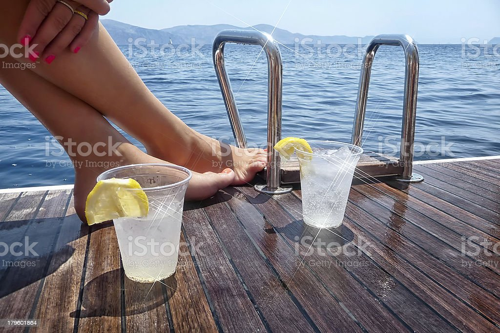 Enjoying drinks on the deck of a sailing yacht royalty-free stock photo