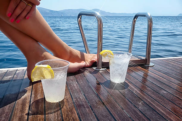 Enjoying drinks on the deck of a sailing yacht stock photo