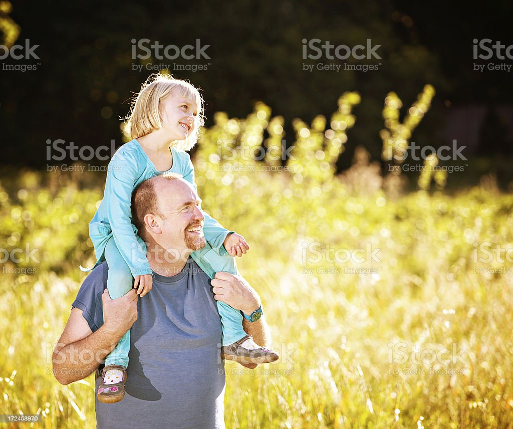 Enjoying fun in the sun, happy father and daughter stock photo