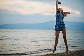 istock Enjoying game of paddle ball at the beach 1266078515