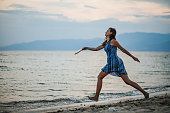 istock Enjoying game of paddle ball at the beach 1266078577