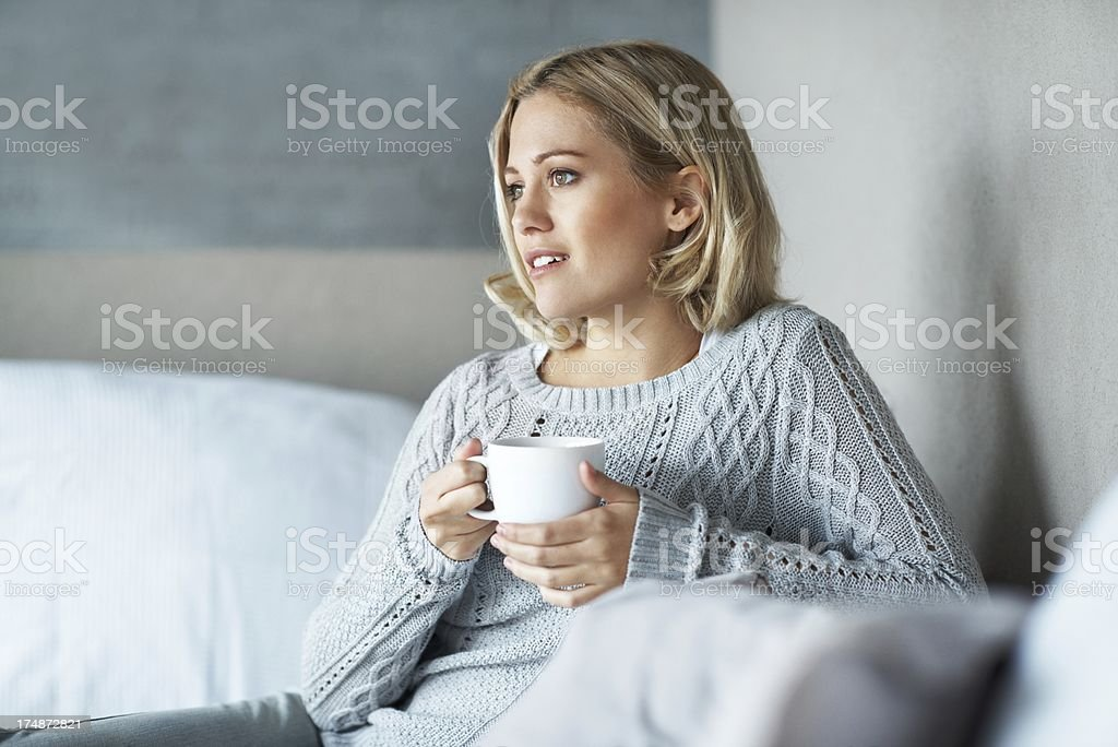 Enjoying her first cup of the day royalty-free stock photo
