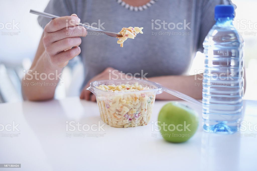 Enjoying her lunch at work royalty-free stock photo