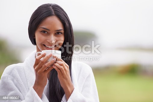 istock Enjoying her morning cup of coffee 484189307
