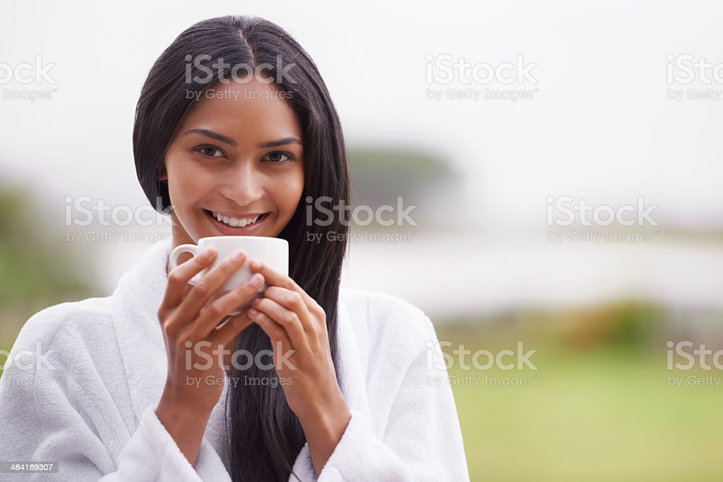 Enjoying her morning cup of coffee stock photo