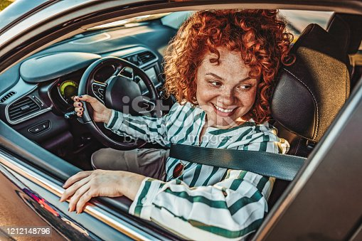 627864748 istock photo Enjoying her new car 1212148796