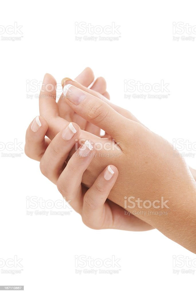 Enjoying her silky smooth skin after a french manicure royalty-free stock photo