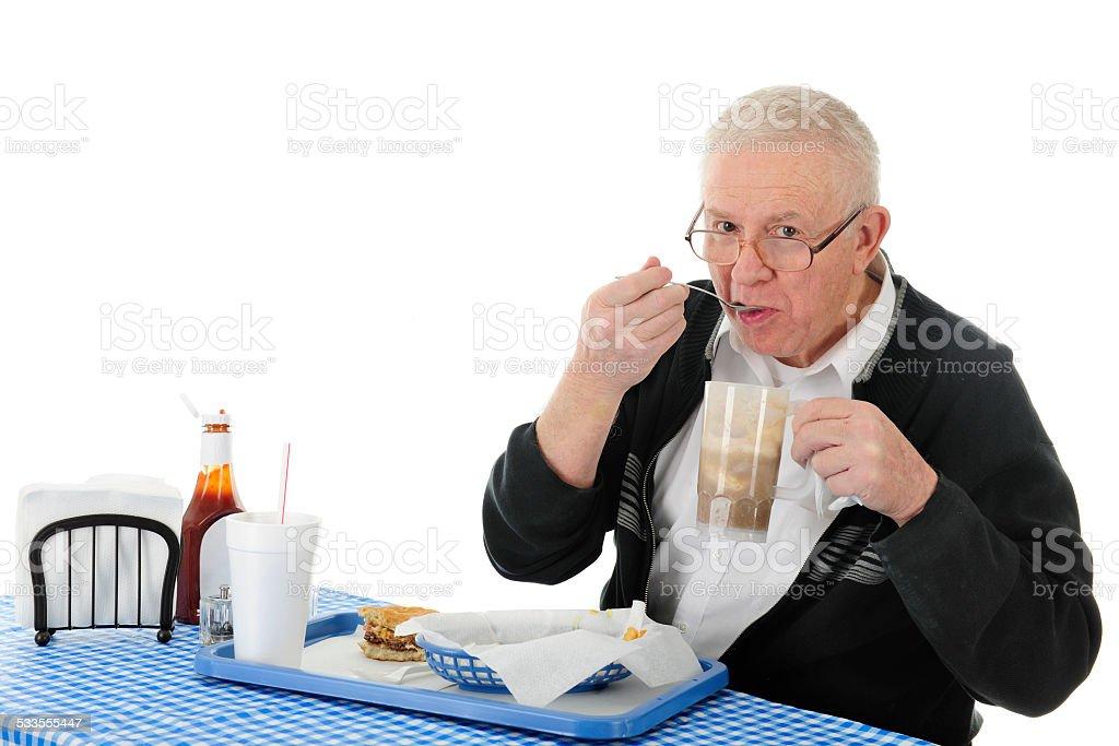 Enjoying His Fast Food stock photo
