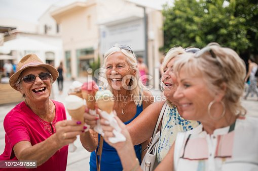 Four older woman on holiday in Cyprus are enjoying ice cream cones.