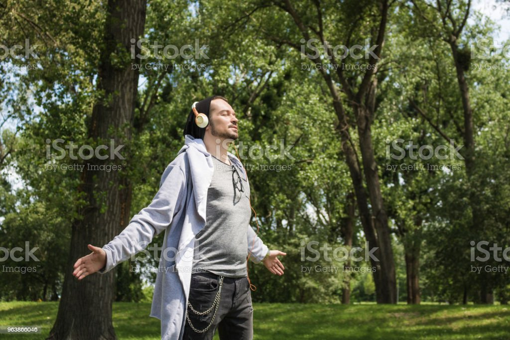 Enjoying in sunshine with arms outstretched. - Royalty-free Achievement Stock Photo