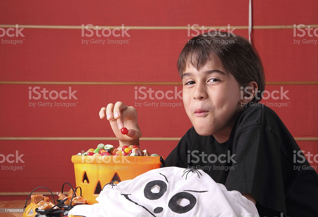 Enjoying my Halloween candies royalty-free stock photo