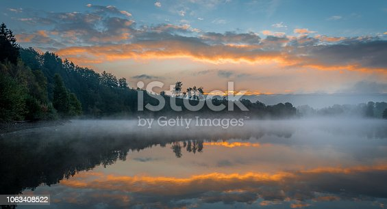 This photograph is taken at Lac de Robertville in Belgium. It was a true magical moment, with the mysterious mist above the water surface and the amazing colors in the sky.