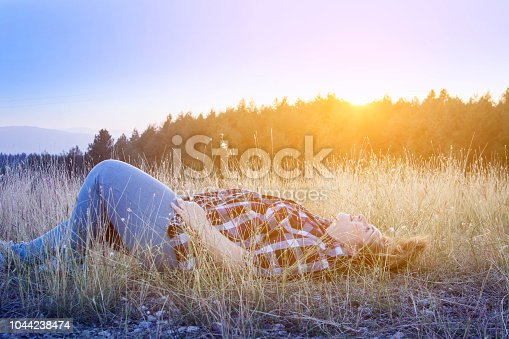 Woman laying down in grass