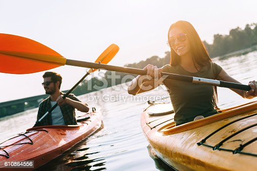 610864024 istock photo Enjoying nice day on river. 610864556