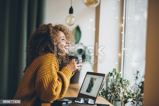 Young woman Enjoying of work and coffee
