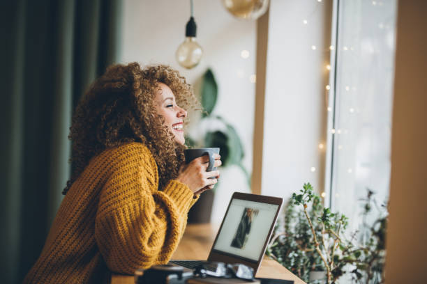 Enjoying of work and coffee Young woman Enjoying of work and coffee sweater stock pictures, royalty-free photos & images