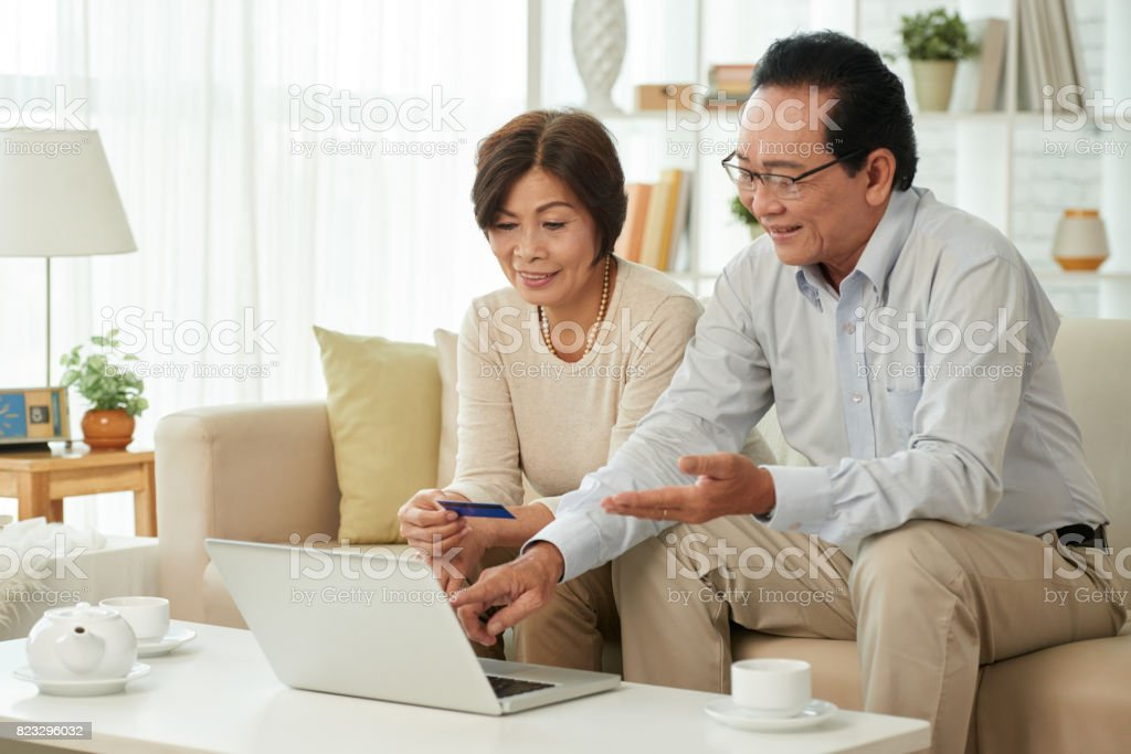 Enjoying online shopping stock photo
