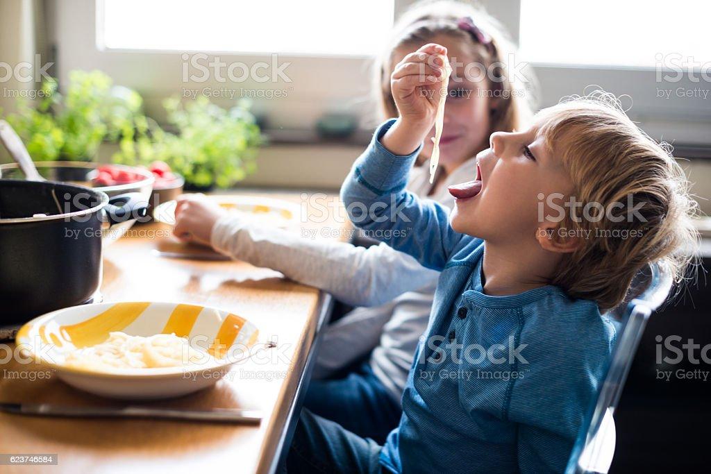 Enjoying pasta time stock photo