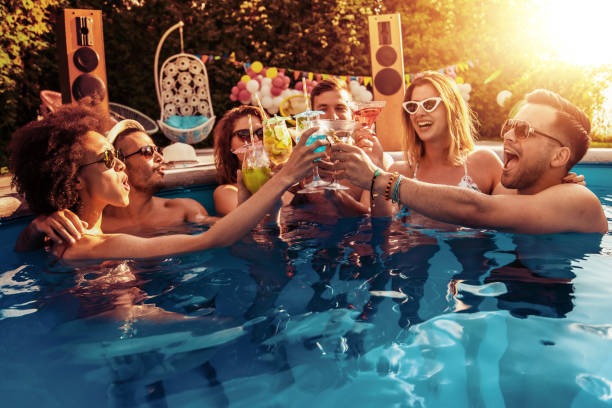 Enjoying pool party with friends stock photo