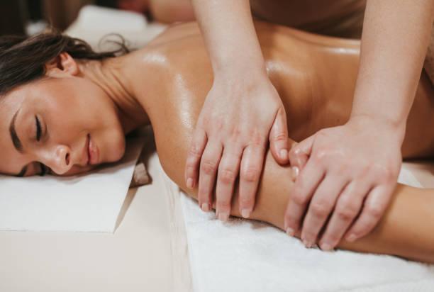Enjoying professional oil massage stock photo