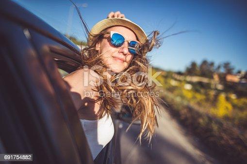 istock Enjoying roadtrip and having fun 691754882