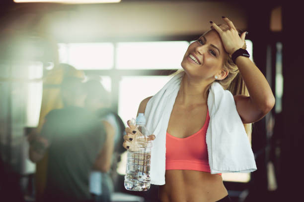 Enjoying some refreshment after gym. Enjoying some refreshment after gym. Woman at gym. health club stock pictures, royalty-free photos & images