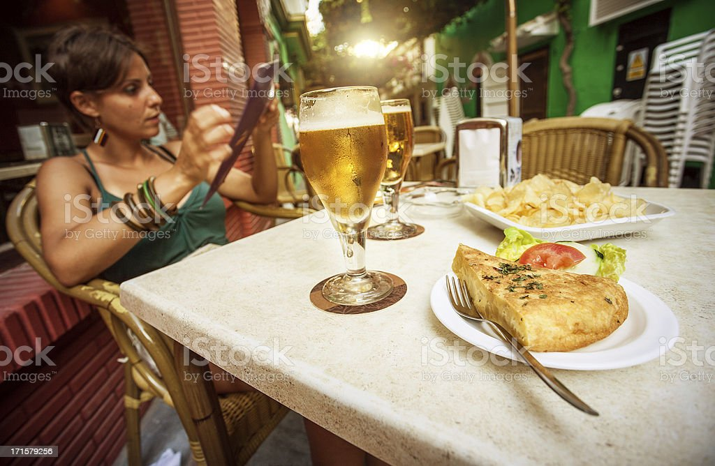 Enjoying Spanish Tapas and Beer stock photo