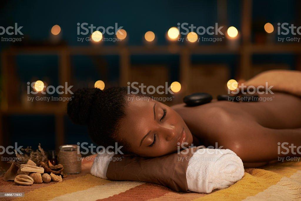 Enjoying stone massage stock photo
