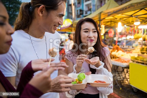 Friends eating local cuisine at a night market