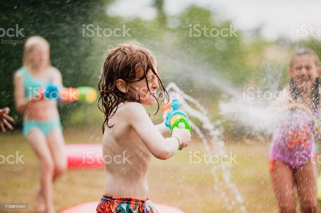 A shot of young children in a garden, they are having fun together...