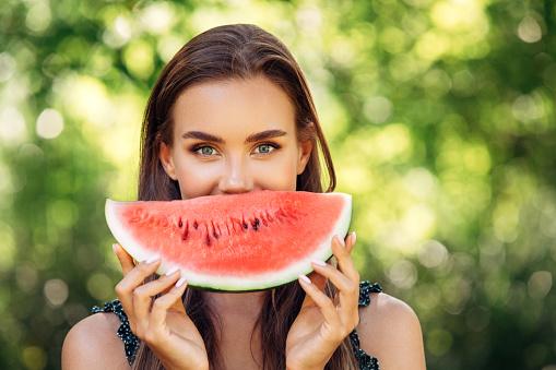 Enjoying sunny day wile eating watermelon