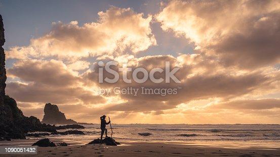 Enjoying sunset at Anawhata beach, Waitakere, Auckland, New Zealand.