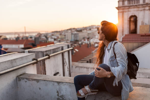 enjoying sunset in lisbon - portugal stock photos and pictures