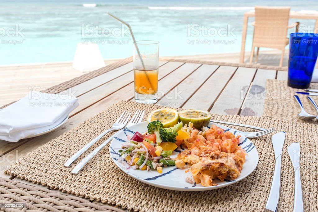 Enjoying tasty breakfast on the sea view terrace stock photo