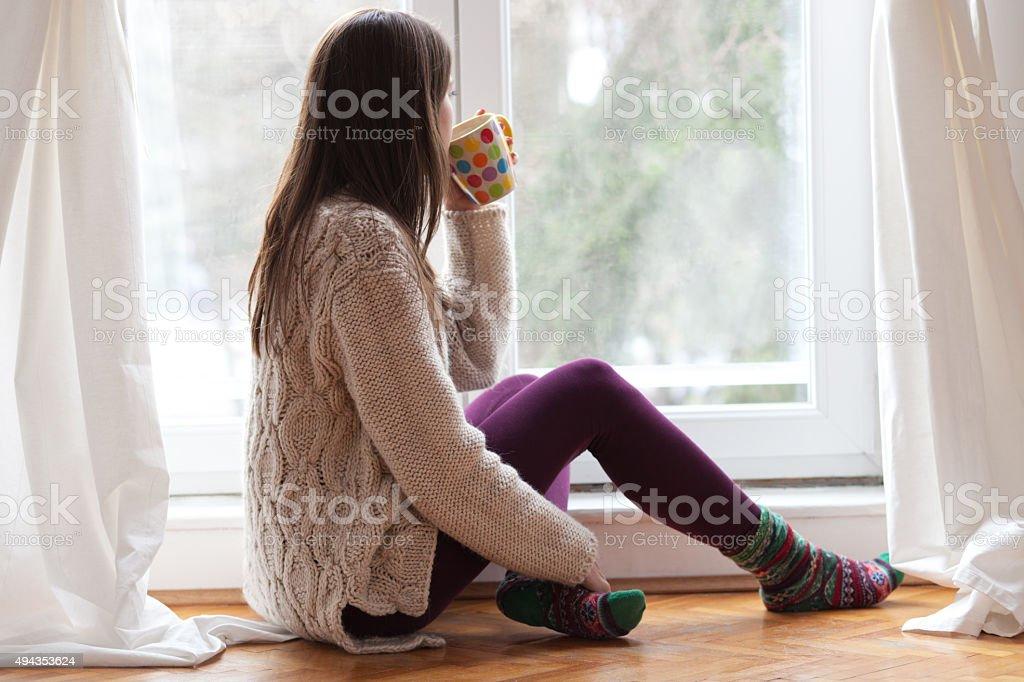 Enjoying tea by the window stock photo