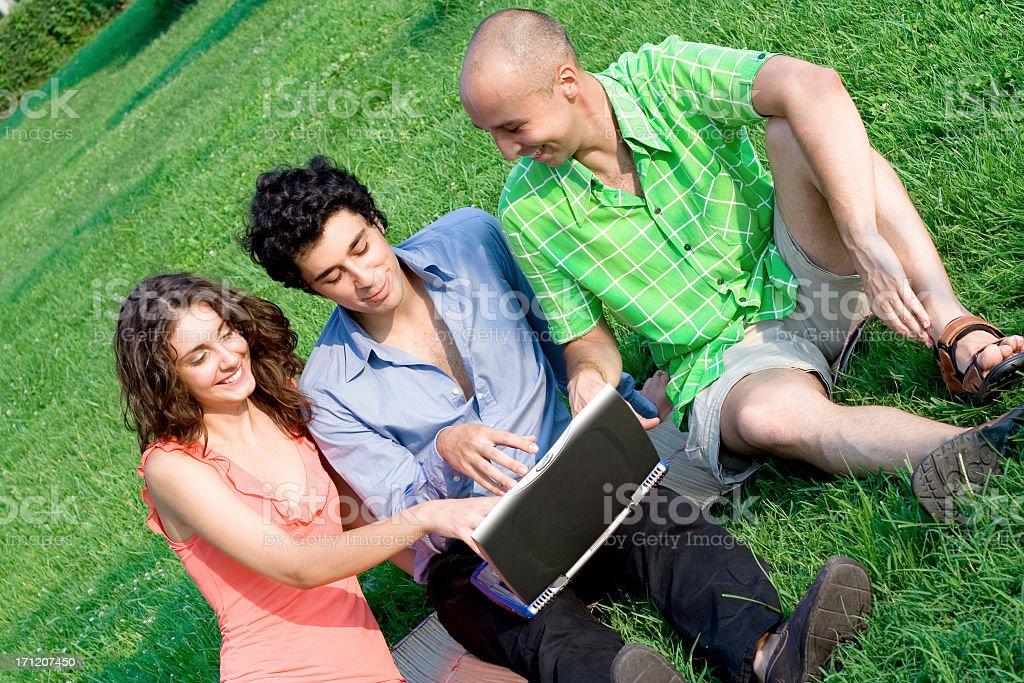 Enjoying technology at the park royalty-free stock photo