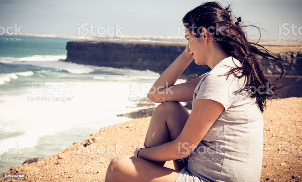 Enjoying the coast and a smile for the future. stock photo