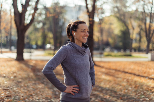 Enjoying the cold fresh air Girl catching breath after morning run walking stock pictures, royalty-free photos & images
