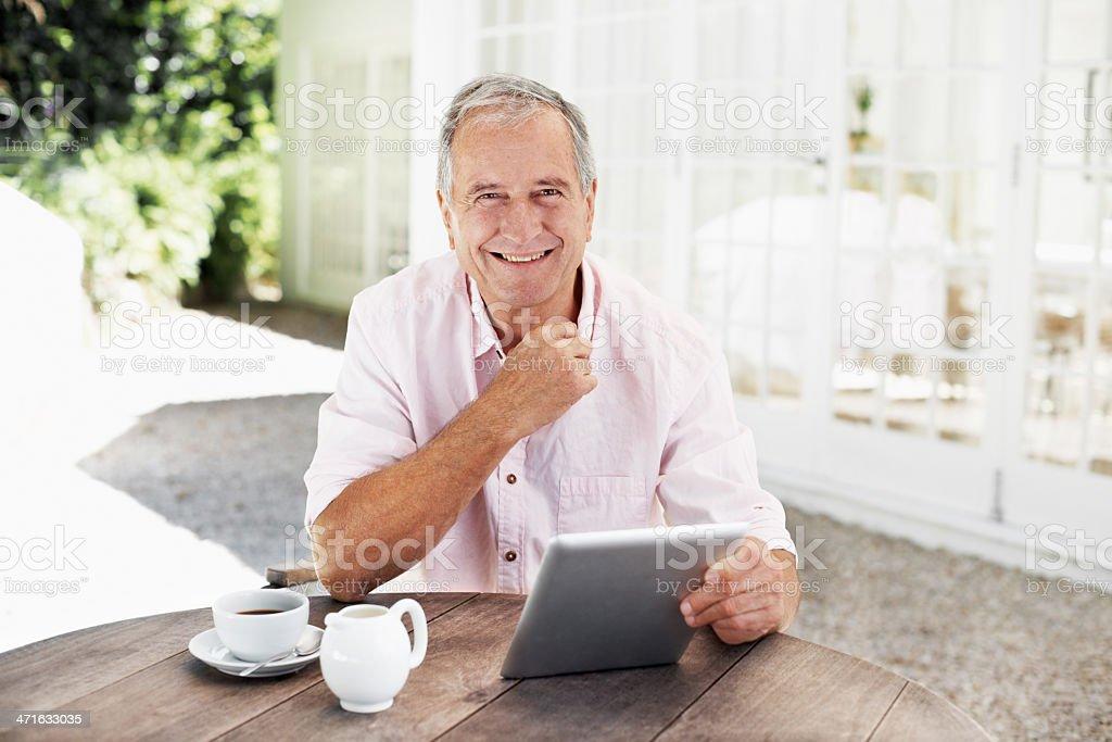 Enjoying the convenience of an e-reader royalty-free stock photo