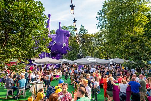 Edinburgh, Scotland, UK - People enjoying sunny weather in George Square Gardens during the Edinburgh Festival Fringe, held annually in August.