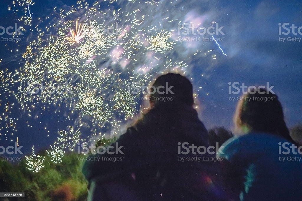 Enjoying the Fireworks - long exposure stock photo