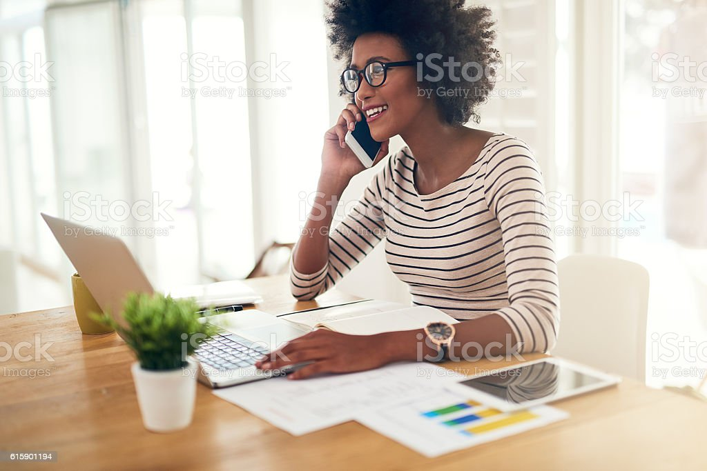Enjoying the flexibility of working from home stock photo