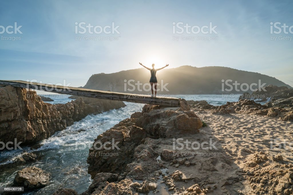 Enjoying the freedom in nature, woman arms outstretched stock photo