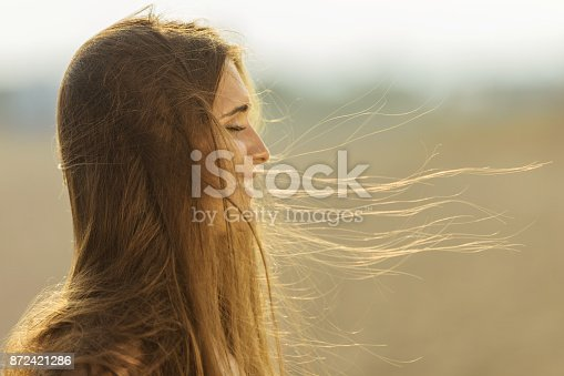 468906855 istock photo Enjoying the fresh sea air on the beach 872421286