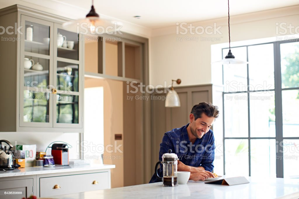 Enjoying the morning online with a coffee stock photo