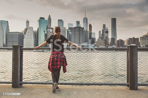 Woman enjoying the view to New York from Brooklyn