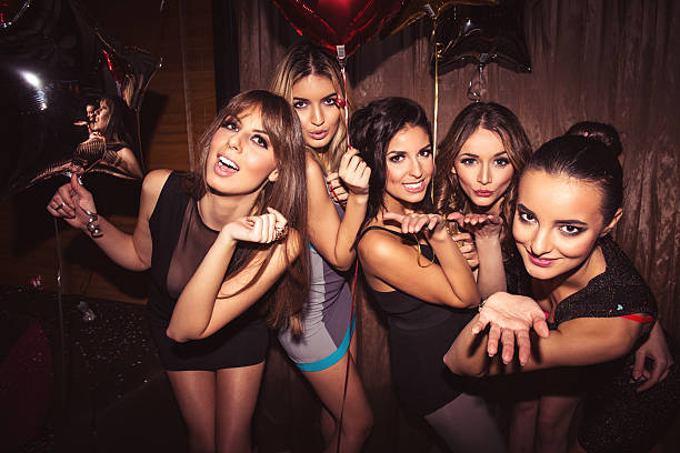enjoying the nightlife - nightclub stock photos and pictures