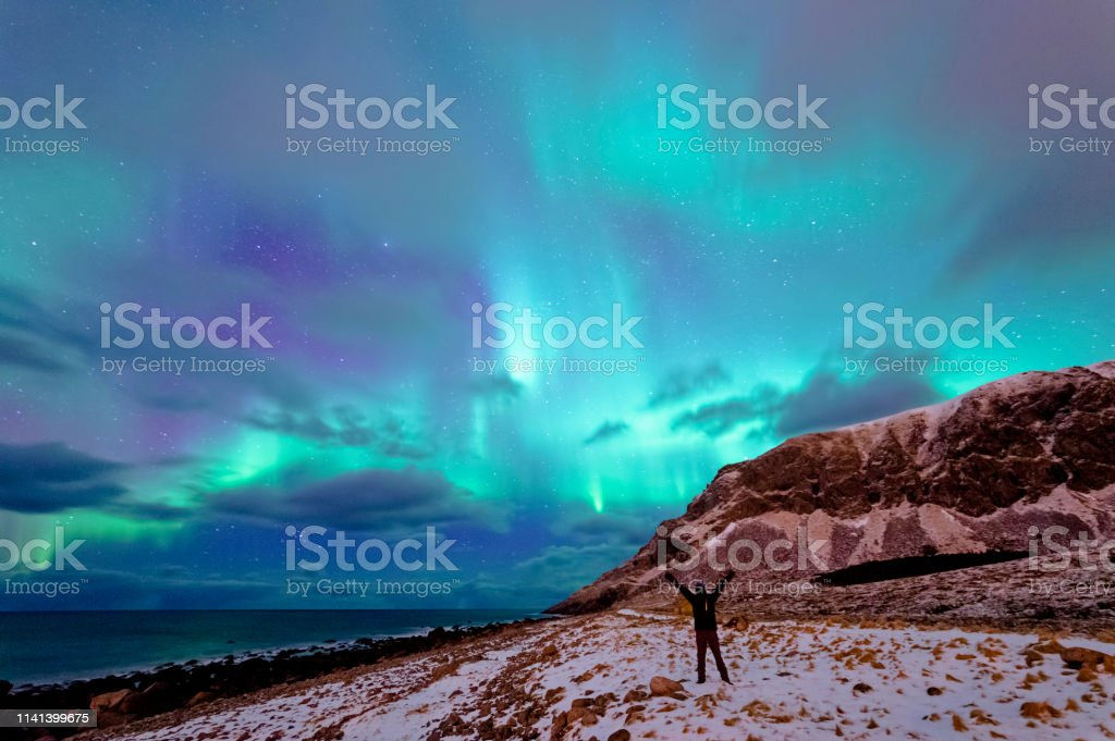 Enjoying the Northern Lights in Unstad stock photo