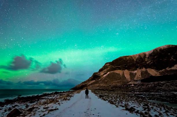 Enjoying the Northern Lights in Unstad stock photo