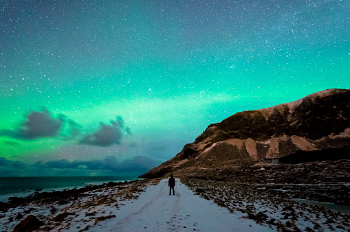 Enjoying The Northern Lights In Unstad Stock Photo - Download Image Now